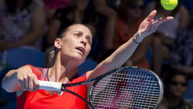 Flavia Pennetta of Italy serves against Samantha Stosur of Australia during their  singles match [AFP]
