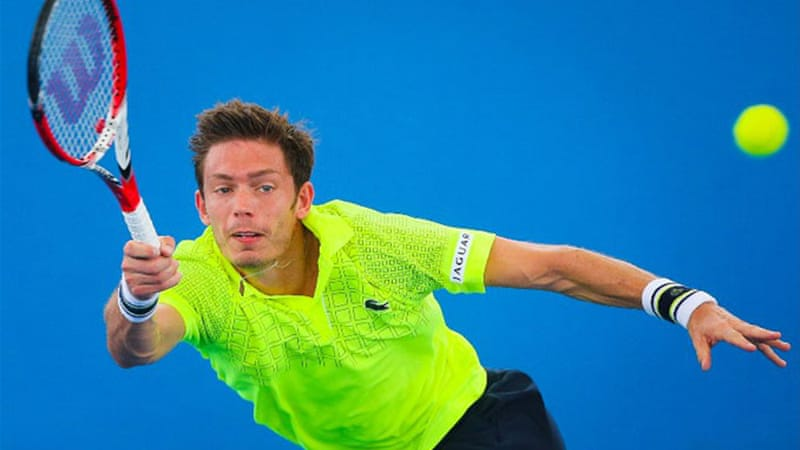 France's Nicolas Mahut hits a return during his second round match against Igor Sijsling of the Netherlands [AFP]