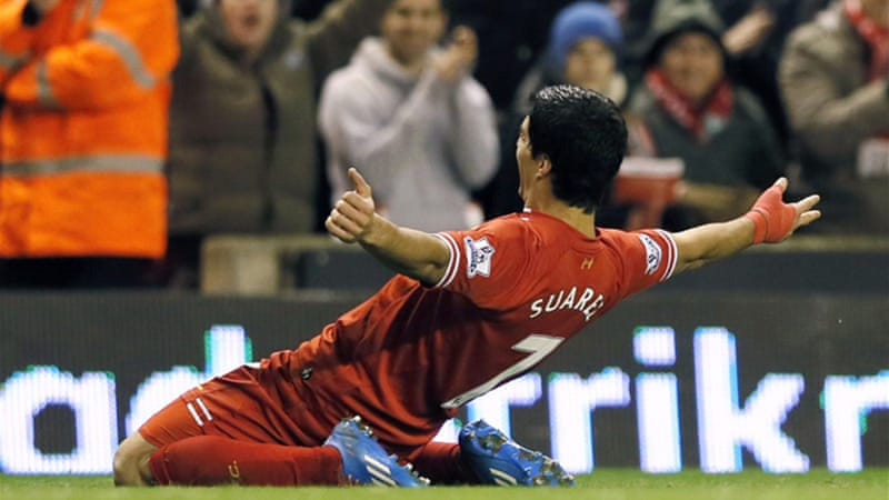 Luis Suarez put on a one-man show scoring four of Liverpool's five goals against Norwich [EPA]