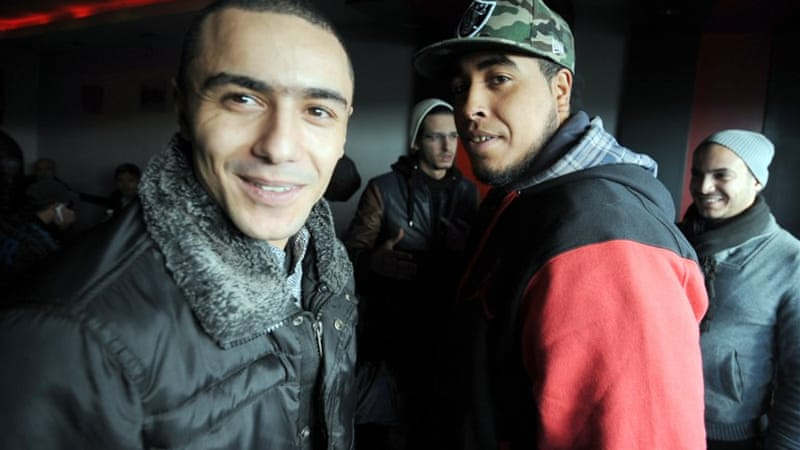 Tunisian rappers Klay BBJ, right, and Weld el 15, left, were sentenced for insulting police in their songs [AFP]