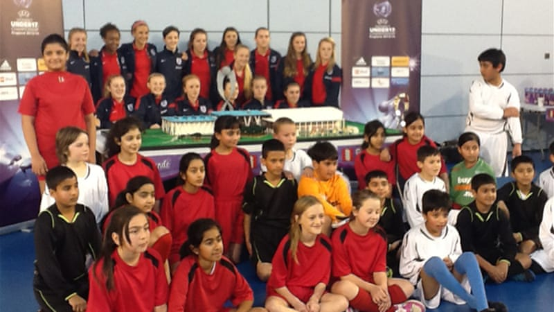 A school group meets the England women's under-17 team [Al Jazeera]