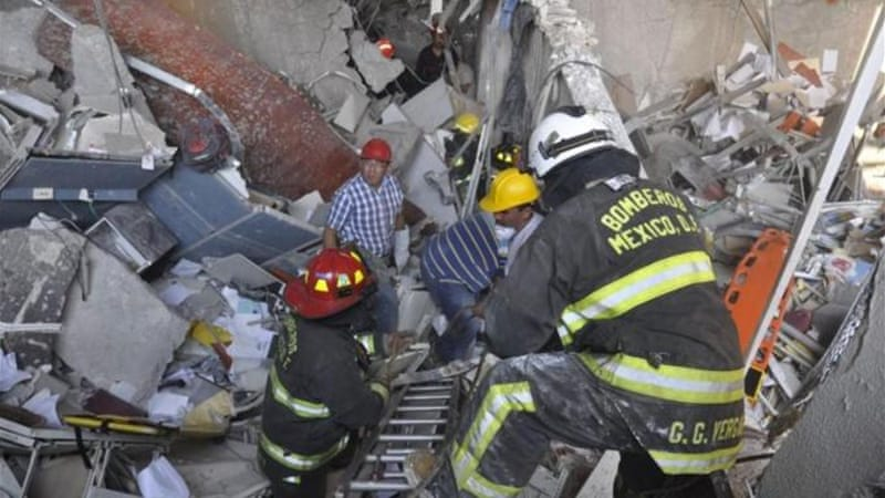 The explosion collapsed several floors of the building and killed dozens of people [Reuters]