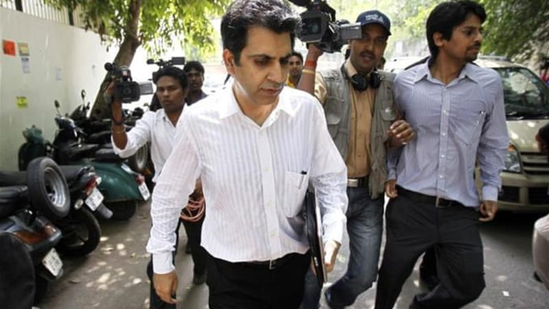 Unitech Managing Director Sanjay Chandra, centre, denies meeting with prosecutors in the corruption case [Reuters]