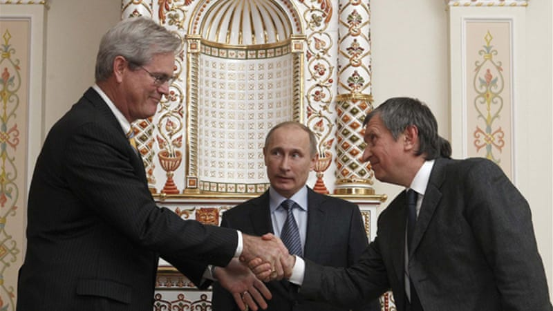 President Vladimir Putin [centre] attended the signing between ExxonMobil and Russian partner Rosneft [Reuters]