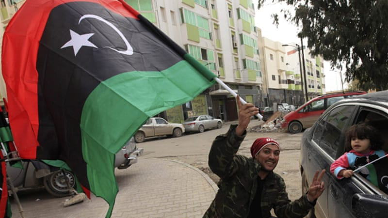Benghazi residents celebrated ahead of the second anniversary of the uprising that ousted Gaddafi [Reuters]