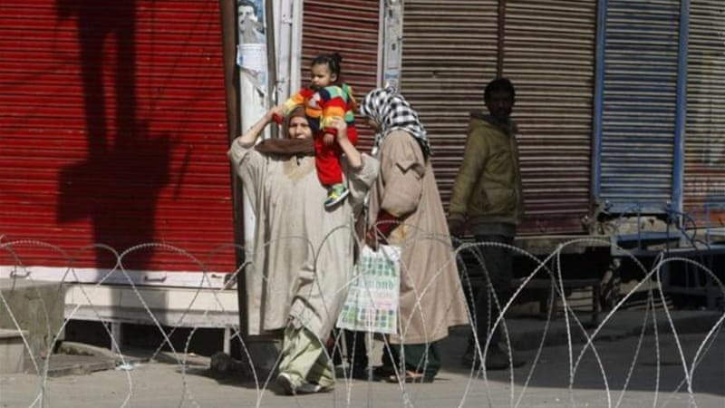 Authorities re-introduced a strict curfew across most of Indian-administered Kashmir before Friday prayers [EPA]