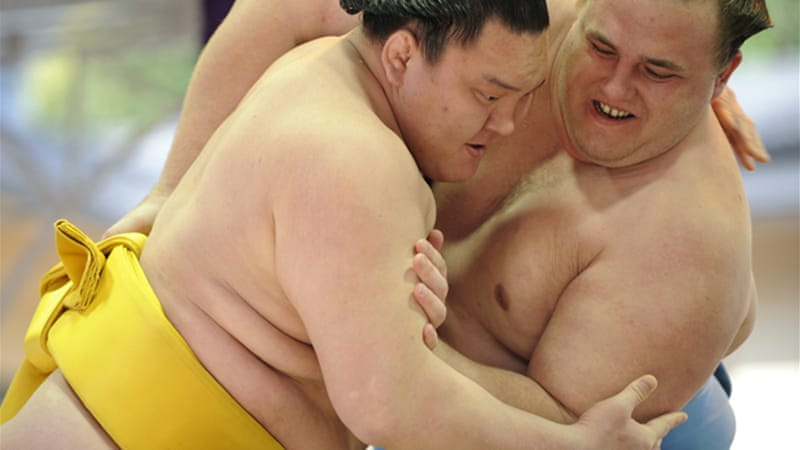The sport of sumo has been tainted in recent years by allegations of match-fixing, drug use and bullying [EPA]