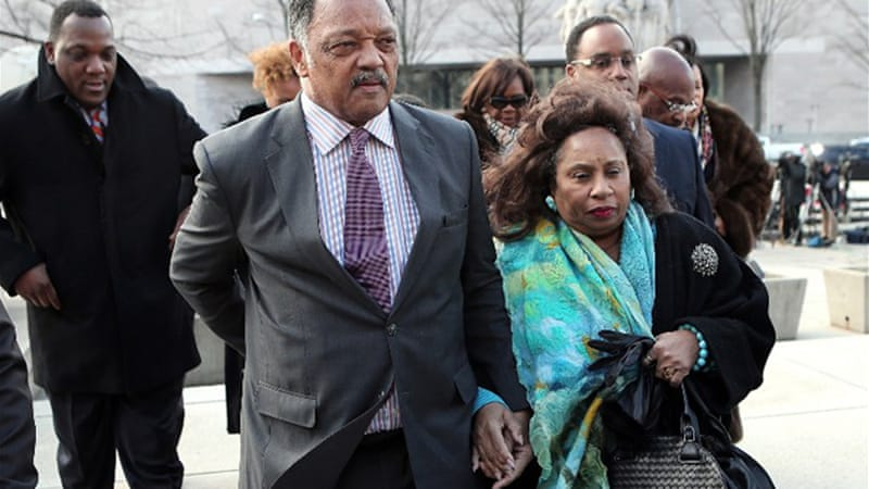 Civil rights leader Jesse Jackson and his wife attended their son's court hearing on Wednesday [AFP]