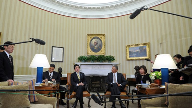 Japanese PM Shinzo Abe (left of Obama) said the two leaders have agreed to deal 'resolutely' with North Korea [AFP]