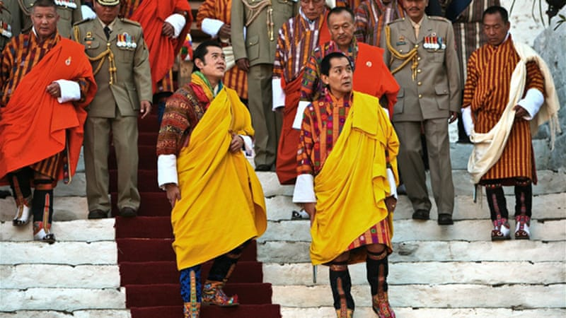 At the insistence of King Jigmi Singye Wangchuck (right), Bhutan in 2004 created gross national happiness as a counterweight to gross national product [Gelay Jamtsho/Solutions Journal]