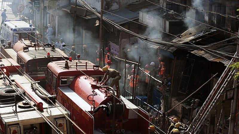 Firefighters found dozens of people lying unconscious on the floors of shops at the Surya Sen market [AFP]