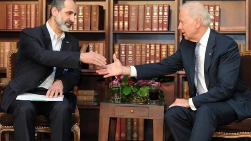 US Vice President Biden, right, urged opposition leader Khatib to continue efforts to maintain unity [EPA]