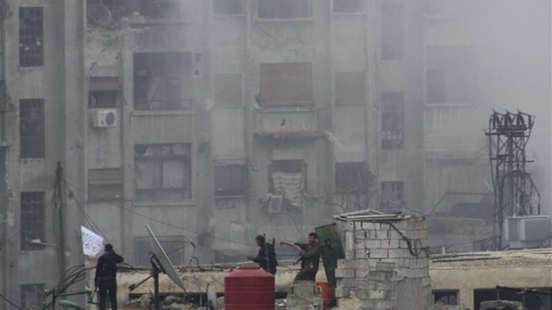 Rebels battled President Bashar al-Assad's forces on the edge of central Damascus, opposition activists said [Reuters]