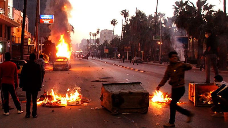 "Protesters and riot police clashed in the northern coastal city of Alexandria in ""Friday of dignity"" protests [AFP]"
