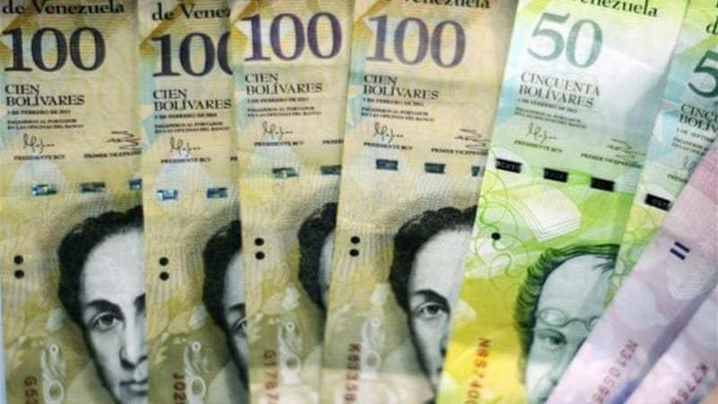 S&P said it expected Caracas to continue confronting fiscal pressures by devaluing the bolivar  [AFP]