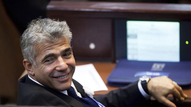Lapid, head of Yesh Atid, has been named as Israel's new finance minister in the coalition government [Reuters]
