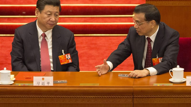 President Xi Jinping, left, and Premier Li Keqiang, right, take over leadership of the government at a crucial time [EPA]