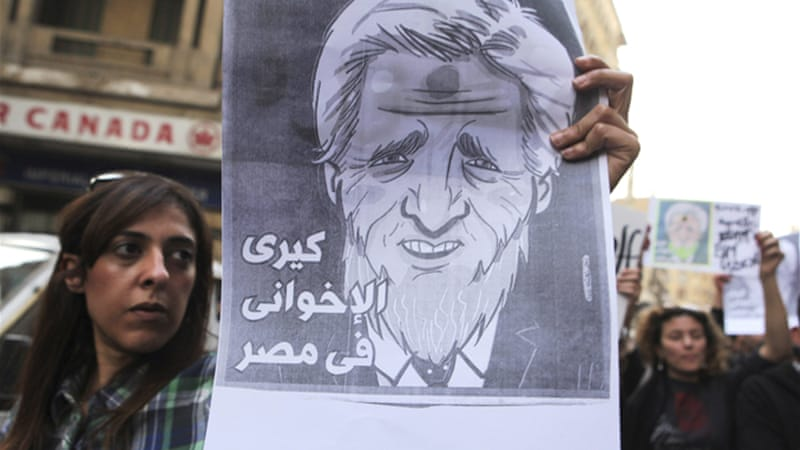 Protesters outside the foreign ministry held signs accusing Kerry of supporting the Muslim Brotherhood [Reuters]