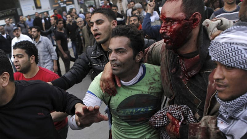 At least 90 injured during clashes between opponents and supporters of the Muslim Brotherhood on Friday [Reuters]