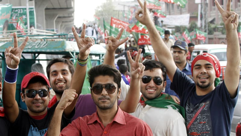 Thousands of supporters of Khan's Pakistan Tehreek-e-Insaf party thronged to Lahore for the rally [EPA]