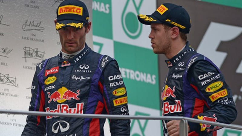 Awkward: After Webber lead Sunday's race in Malaysia, Vettel overtook his teammate against team orders, leading to a frosty reception on the podium [AFP]