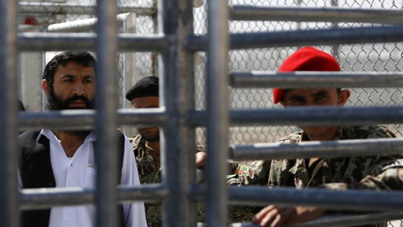 A prisoner stands in line for his release during a ceremony handing over the Bagram prison to Afghan authorities, at the US airbase in Bagram, north of Kabul March 25, 2013 [Mohammad Ismail/Reuters]