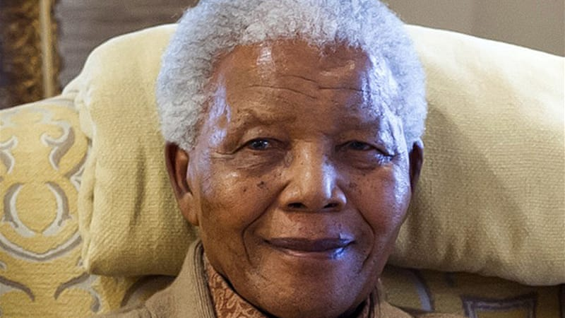 Mandela's grandson said his grandfather was getting better and was expected to be discharged soon [AFP]