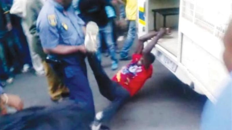 A video was released showing a taxi driver as he was dragged behind a police van while police officers watch [EPA]