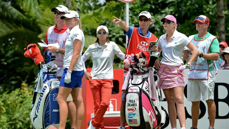 Lewis, second left, the 2012 LPGA Player of the Year, shot a 1-under 71 in the final round to finish at 15-under 273, one stroke ahead of South Korea's Choi Na-Yeon [AFP]