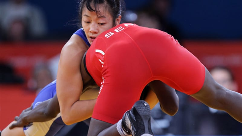 Olympian Carol Huynh, pictured above in blue, said the IOC decision would drastically affect federal funding in Canada for wrestling [EPA]
