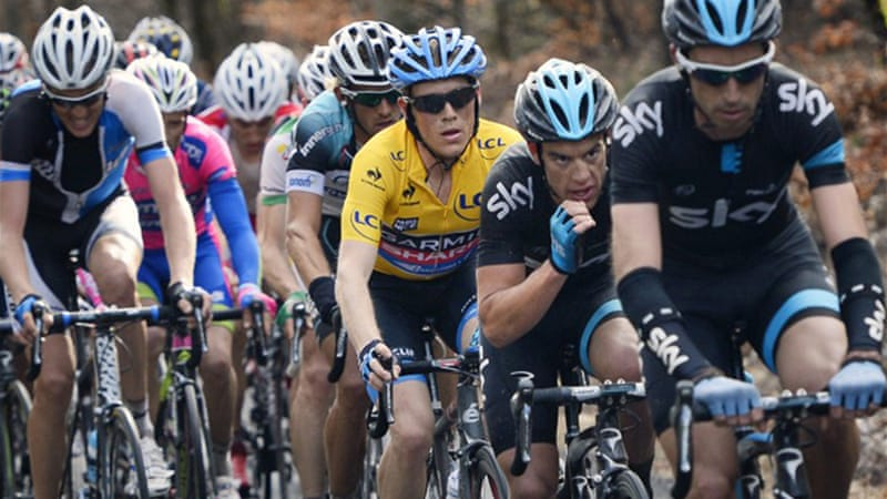 Australia's Richie Porte, pictured centre,  retained the yellow jersey, holding a 32-second lead from American Andrew Talansky [AFP]