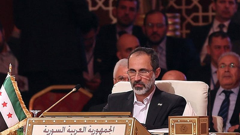 Khatib gave a bleak account of the humanitarian crisis in Syria at the Arab League summit in Doha [AFP]
