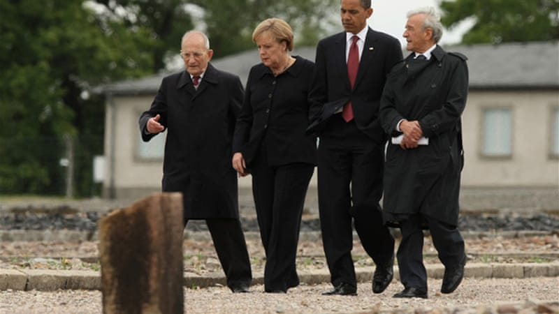 US President Barack Obama with Angela Merkel and Holocaust survivor Elie Wiesel (right) at the former Buchenwald concentration camp near Weimar in Germany [Getty Images]