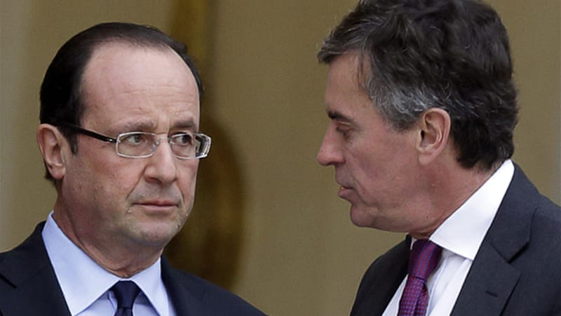 Hollande's party is struggling over a tax-fraud scandal involving Cahuzac, right, former budget minister [Reuters]