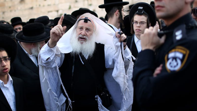 Some ultra-Orthodox Jews oppose moves to allow women and men to pray together at the Western Wall [EPA]
