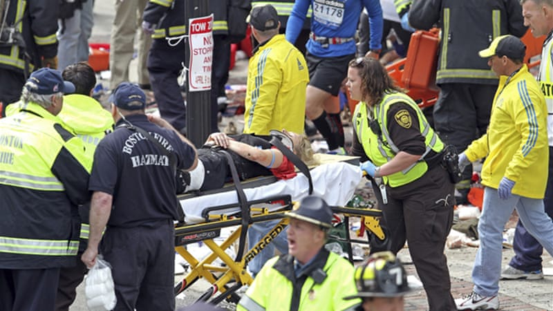 At least three people were confirmed dead and dozens injured in two powerful explosions in Boston [EPA]