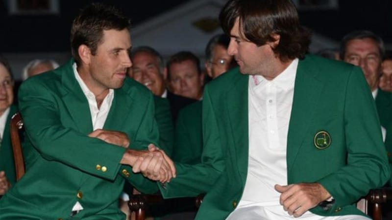 Golfing masters: 2012 Masters champion Bubba Watson (R) shakes hands with 2011 winner Charl Schwartzel [AFP]