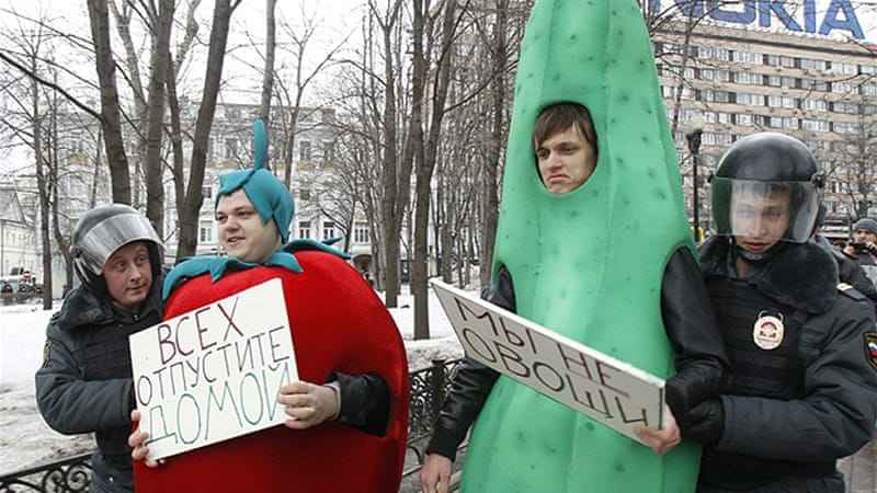 Police detained protesters who had signs saying 'we are not vegetables' and 'release everybody home' [Reuters]