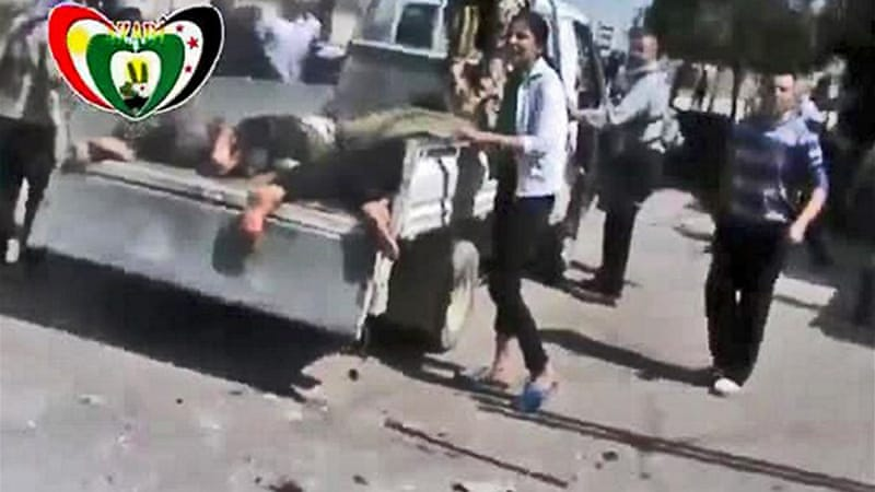YouTube video image grab shows bodies after airstrike on mainly Kurdish district of Sheikh Maqsoud in Aleppo [AFP]
