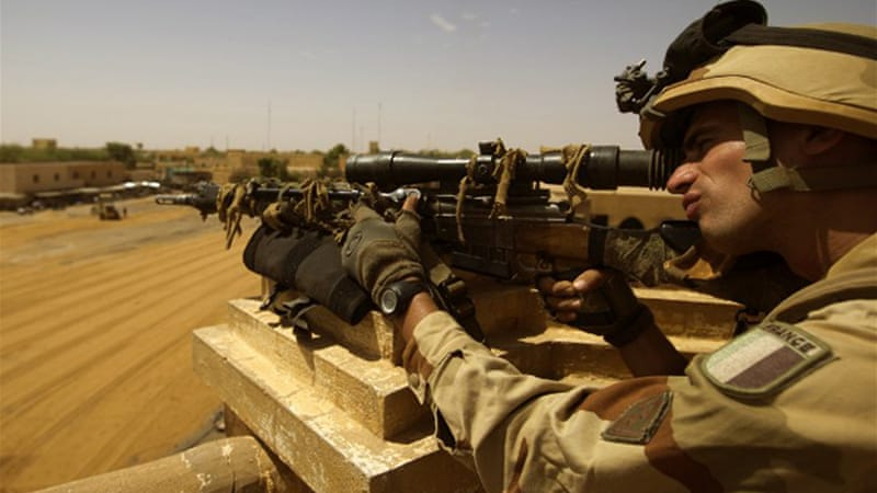 The number of French troops in Mali will be halved to 2,000 by the time of a presidential election in July [AFP]