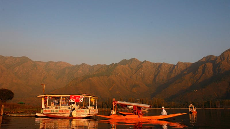 Dal Lake, where a woman's body was discovered on a houseboat,  is a popular tourist destination [Getty]