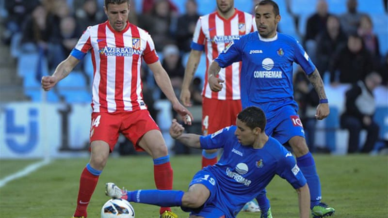 Atletico Madrid slipped three points behind second-placed champions Real Madrid after the draw at Getafe [AFP]