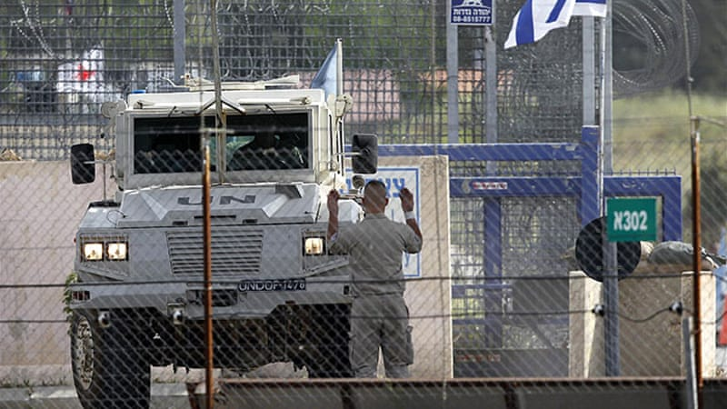 Four Filipino UN peacekeepers were handed over on Sunday at a border checkpoint called Beit Ara [File: AFP]