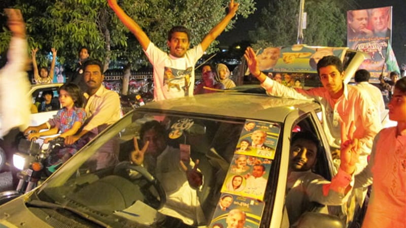 PML-N supporters celebrated the election victory of Nawaz Sharif late into the night [Asad Hashim/Al Jazeera]