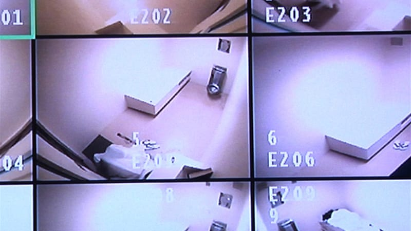 This April 16, 2013 video frame grab reviewed by the US military, shows live streaming video of detainees' cells - some empty, while other frames show detainees pacing or sleeping, in Camp 6 at Guantanamo Bay Prison [AP]