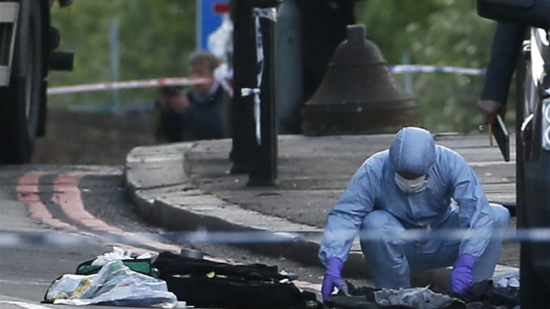 Police forensics officers investigated the crime scene where the man was killed [Reuters]