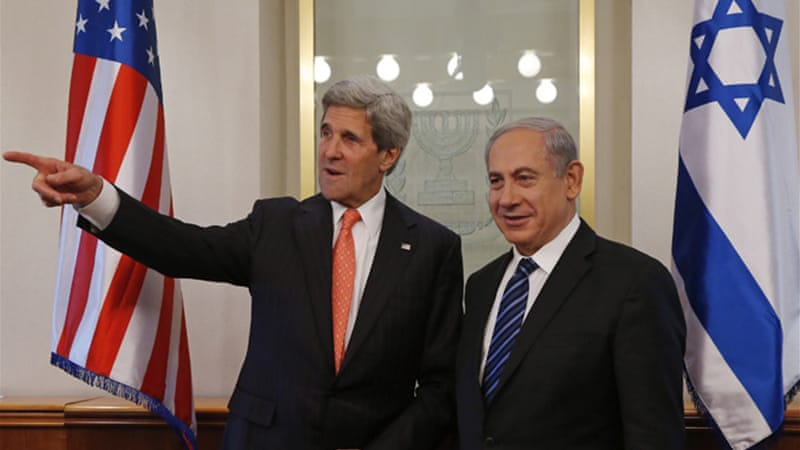 In a visit with Israeli PM Binyamin Netanyahu, Kerry said Iran's system obstructs democracy [Reuters]