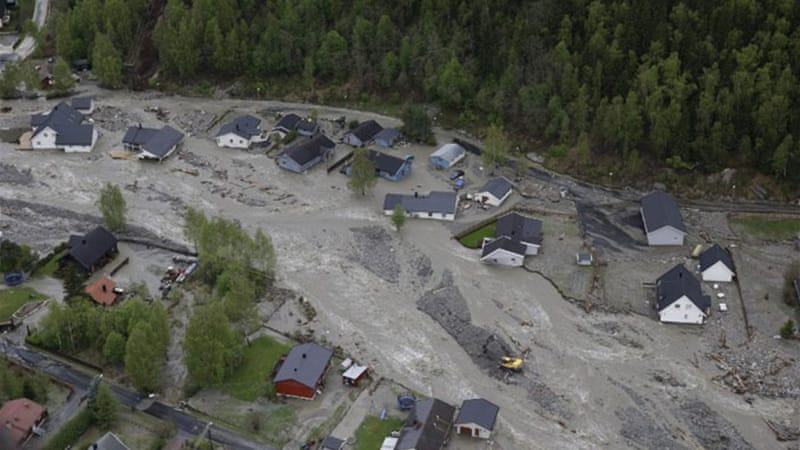 A number of rivers in eastern Norway have burst their banks inundating homes and triggering landslides [AFP]
