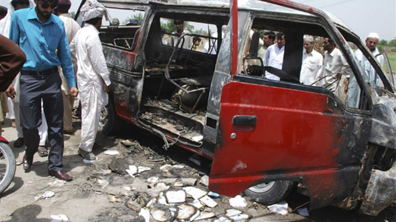 The van was carrying 24 children to a school in Gujrat when it caught fire, according to local police [Reuters]