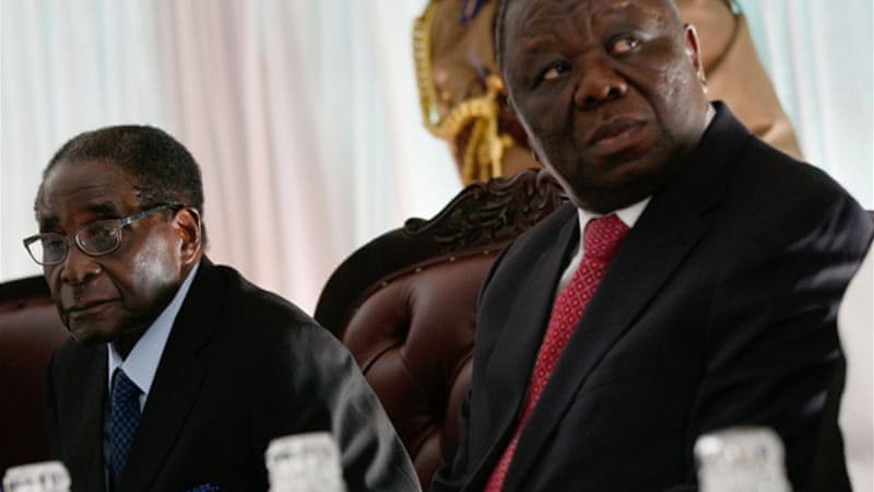 Prime Minister Morgan Tsvangirai, right, wants reforms before the poll to ensure a free and fair vote [EPA]